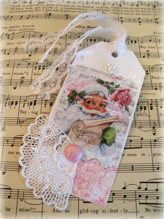 Pink Santa compliments of the season gift tag